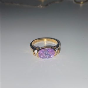 4K gold ring with diamond and purple jewel